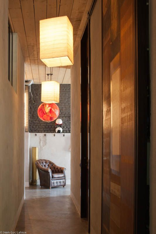 Statement pendants breathe life and style into a narrow hallway Ambient lighting in bathroom and hallway #designer #bespoke #lighting #lightingideas #architecture #home #design #interiors #interiordesign