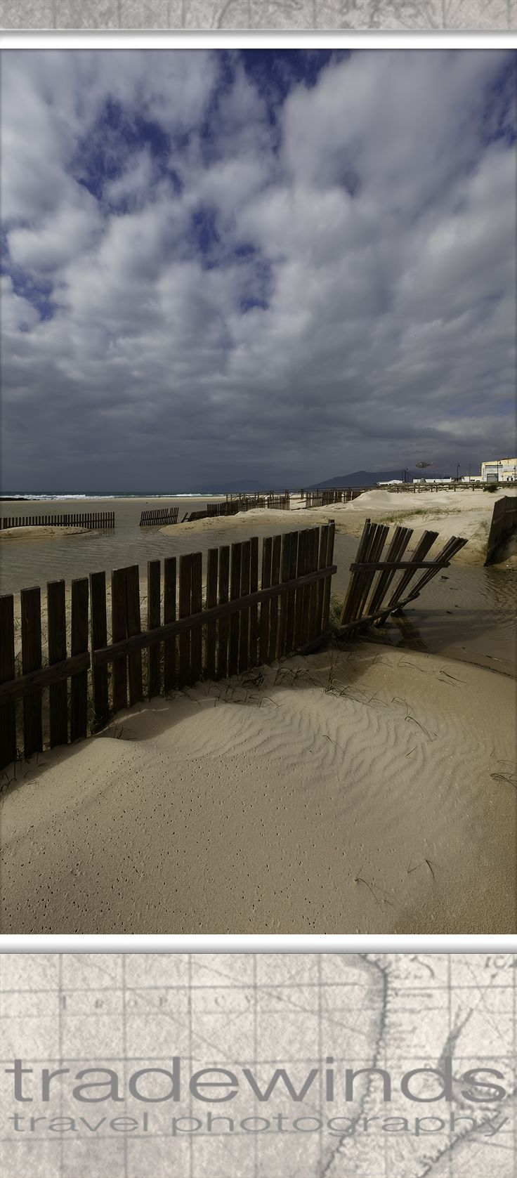 fences on los lances beach in tarifa, spain