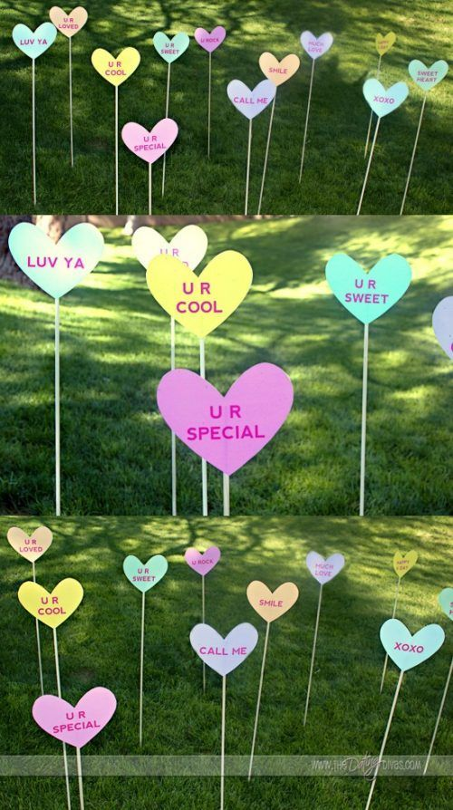 Give your front lawn a heart attack with paper candy hearts on a stick and Valentine Home Decor Ideas on Frugal Coupon Living. Outdoor Valentine Decorations.