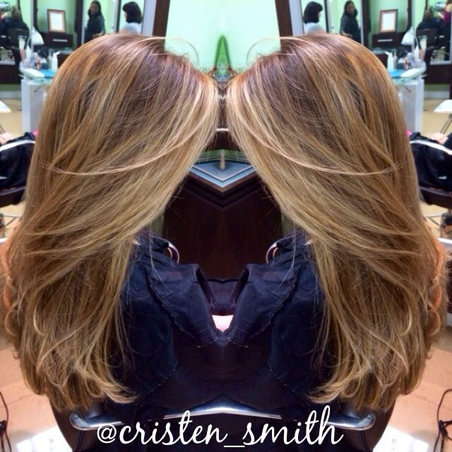 Balayage highlights with face framing pieces. Not sure if that blonde of blonde would look