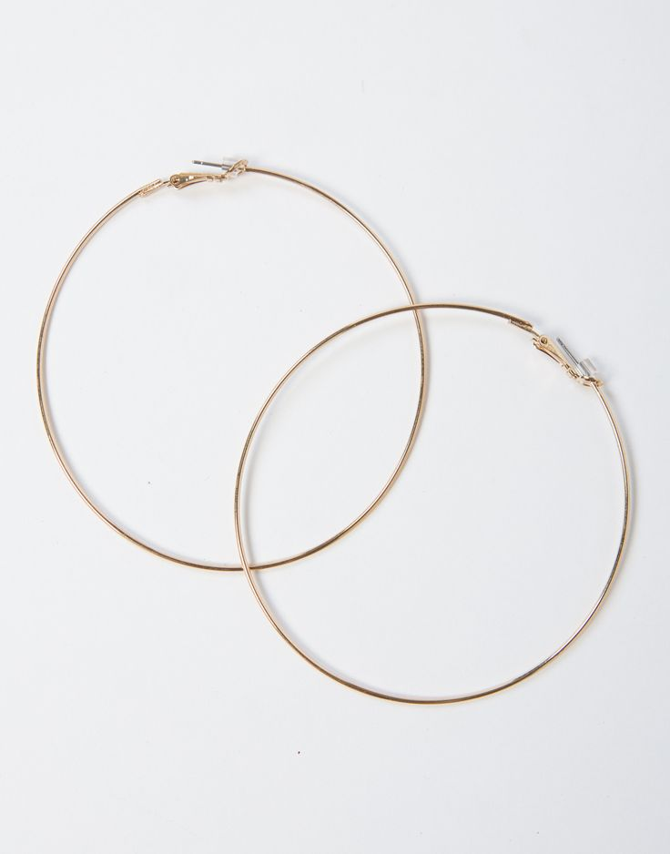 Sometimes all it takes is a pair of Classic Large Hoop Earrings to complete your look. Features a thin medium sized hoop with a leverback for closure. These gold earrings are the perfect option for ev