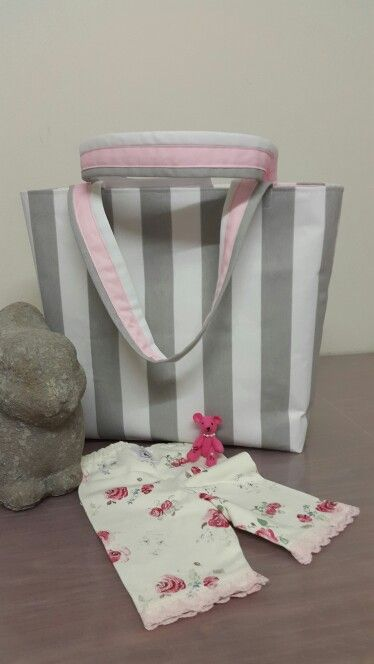 Pale gray and white stripe box bag with pink lining . Ordered for the mum of a future princess