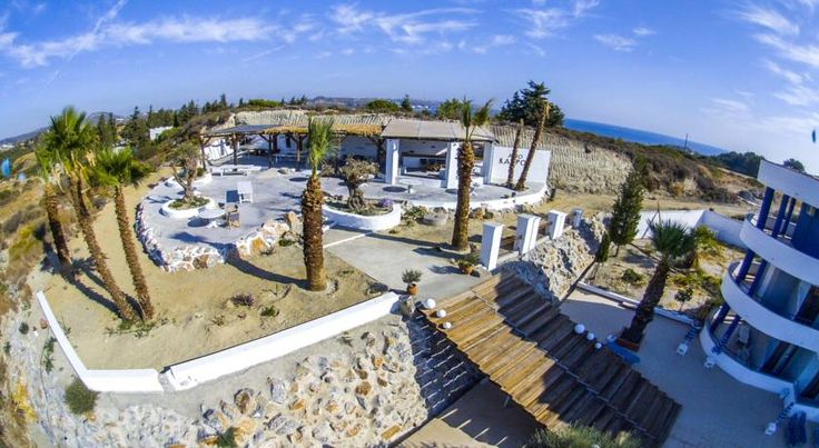 Ano Kampos Hotel & Studios Faliraki Peacefully situated on a hill in Ladiko, Ano Kampos Hotel & Studios offers air-conditioned accommodation, just 2 km from Faliraki beach. It has a swimming pool, a separate children's pool and a snack bar.  All rooms include a fridge and a safety box.