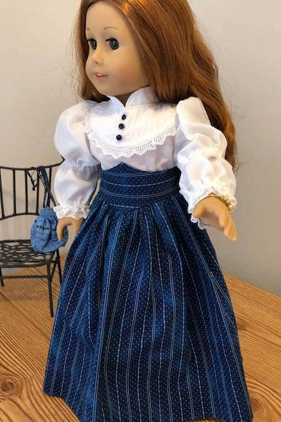 Dark blue with pale blue stripes Victorian Skirt / Heirloom Blouse / and Purse fits American Girl Dolls This skirt and delicate rayon blouse , a great everyday Victorian outfit. The Blouse is made with delicate white rayon fabric. The blouse has a pintucked yoke bodice with