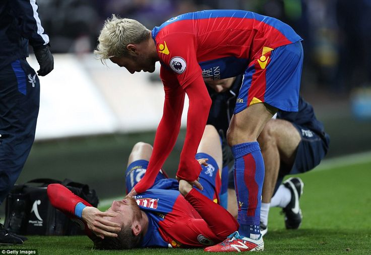 French midfielder Yohan Cabaye comforts the 23-year-old English forward after picking up his injury on Saturday