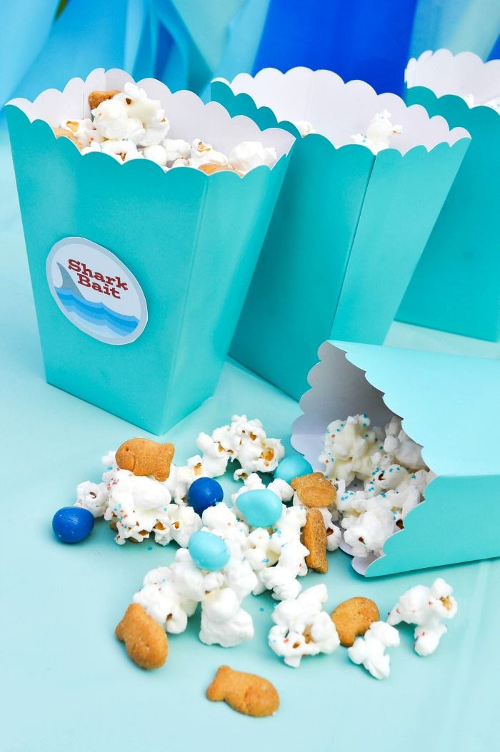Throwing an ocean themed party? You will definitely want to include this Ocean Party Popcorn mix we made as a Shark Party Snack. It's the perfect sweet and salty snack mix that everyone will love! | The Love Nerds