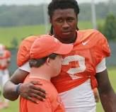 Clemson football - Sammy Watkins hugging the team manager who has Down's Syndrome. There's an amazing video online about this boy that will make you love these kids and the University even more than you do!