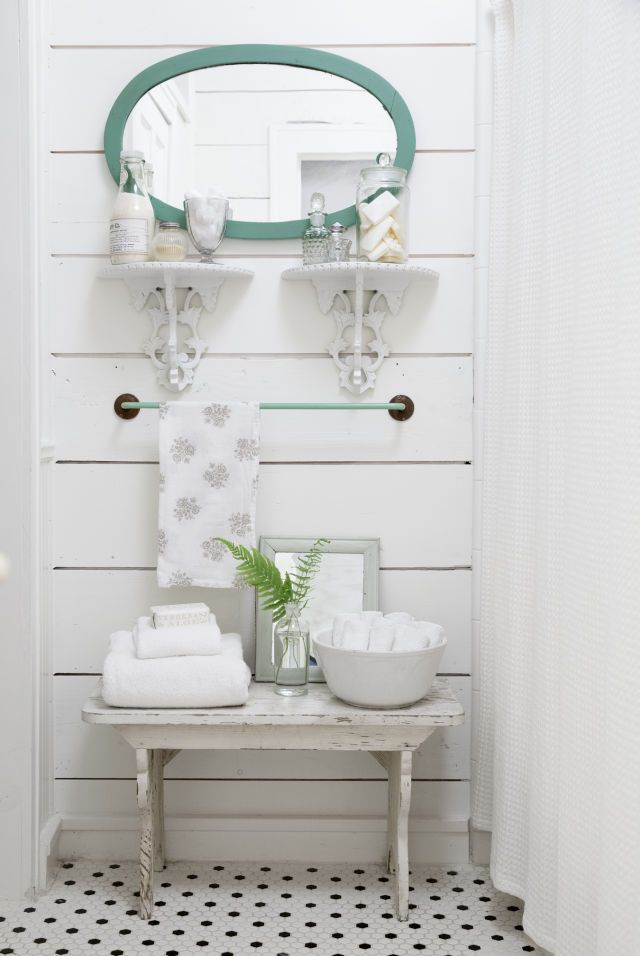 In the downstairs bathroom, owner Cindy Williams added pops of green including the jadeite towel bar, which she found on eBay, and a mirror from Antique Company Mall in McKinney.
