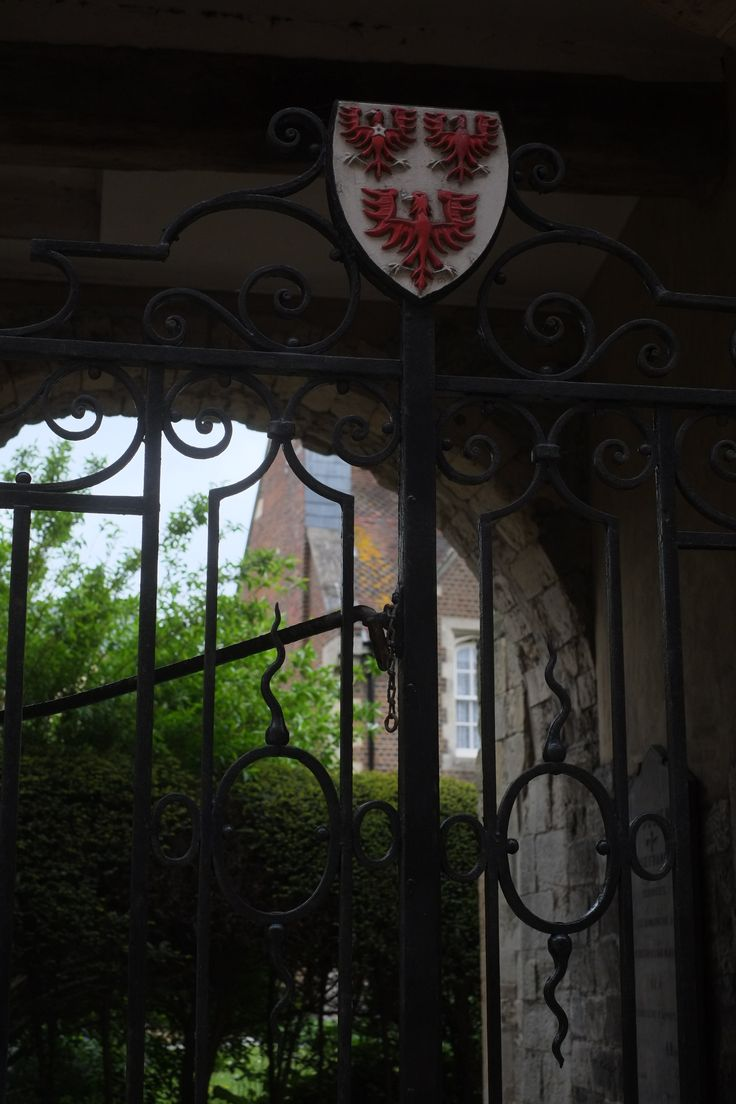 Queens College Oxford crest on gate to St Juliens
