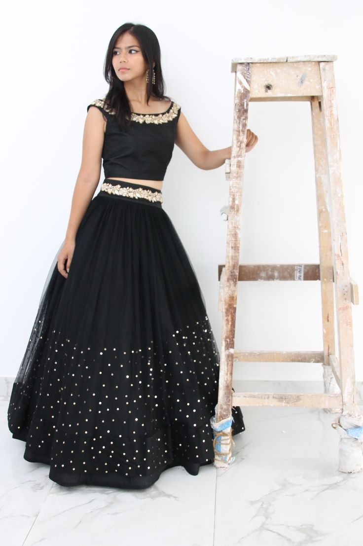 Black off the shoulder crop top with rosette embroidery in raw silk and a black lehenga with rosette embroidery on the waist band and sprinkle embroidery on the skirt in tulle