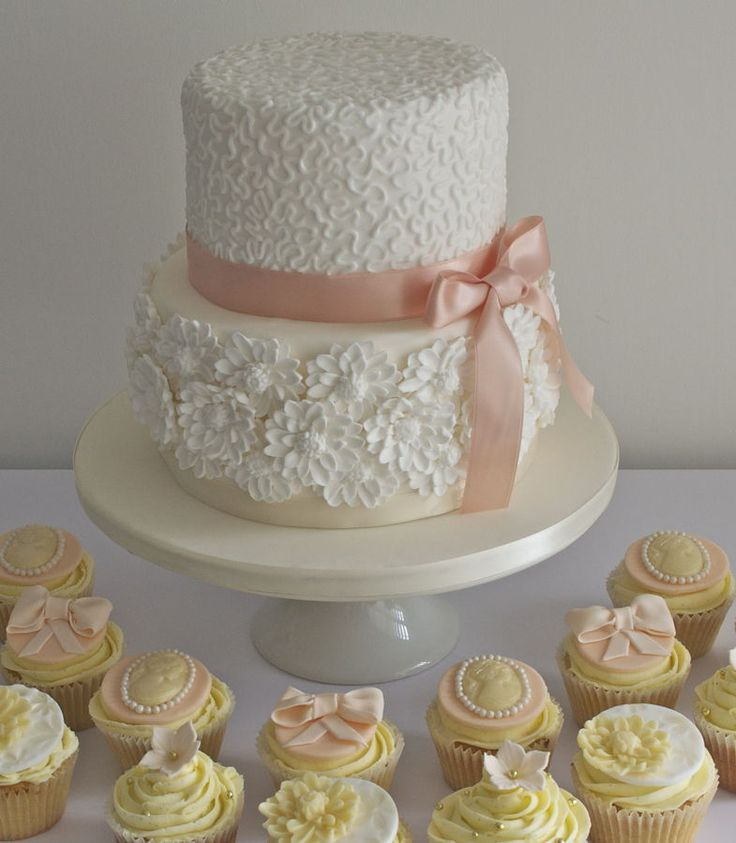 Two Tier Wedding Cake Ideas | 2t Wedding Cake With Yellow Cupcakes And Pink Ribbons
