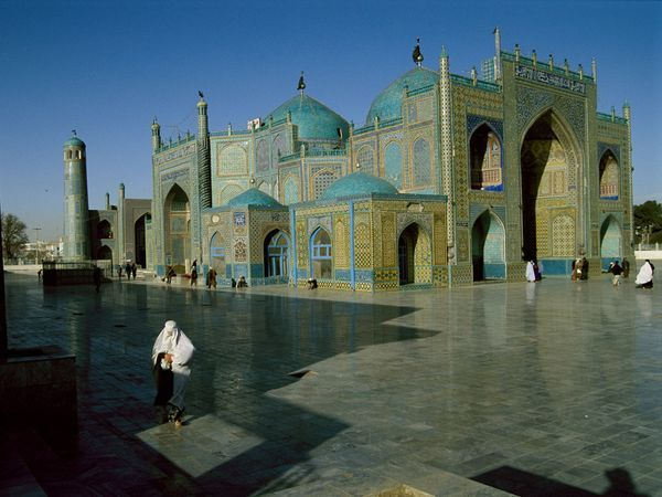 Afghanistan Mosque  Photograph by Steve McCurry    Deep ethnic and religious divides are briefly bridged at the Hazrat Ali mosque in Mazar-e Sharif, Afghanistan, where Sunni and Shiite alike come to pray. The shrine is believed by many to be the tomb of the Prophet Muhammad's son-in-law.
