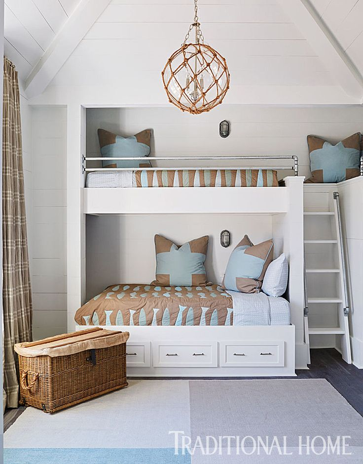 The bunk room is ready for sleepovers with one full-size bed and five twins. Sweet! - Photo: Jean Allsopp / Design: Mary McWilliams and Kenson Bates