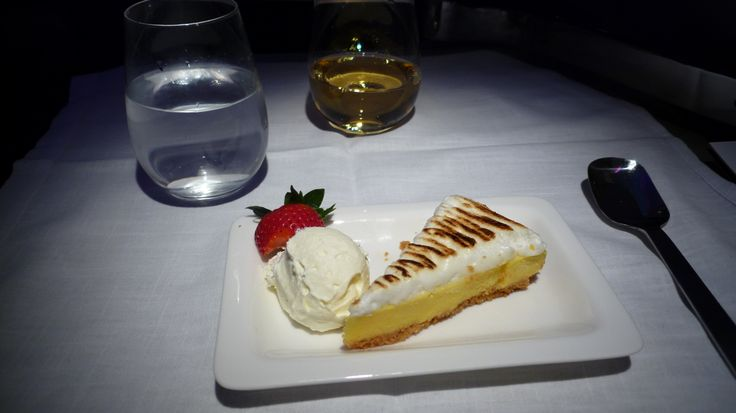 Dessert. Lemon Meringue Pie with Vanilla bean ice cream, and dessert wine.  Air New Zealand Business Premier, NZ2, LAX-LHR, Boeing 777-300ER. 28/05/2012