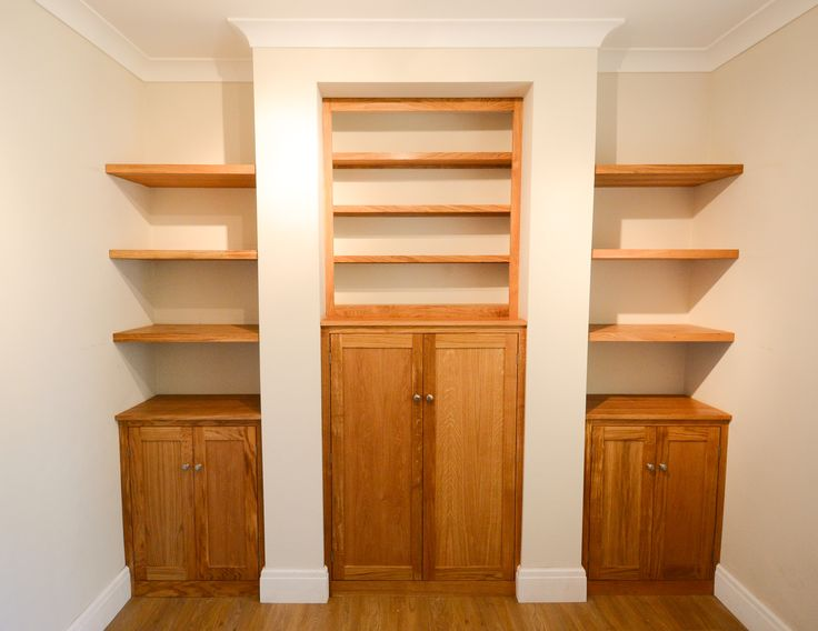 Oak alcove storage cabinets -   Custom made for a customer in Upton-by-Chester.  The cabinets were made from prime grade european oak with real oak veneer panels.  Torsion box floating shelving, wrapped in real oak veneer with solid oak fascias, providing able support for heavy books and files.  Perfect for a home office solution.