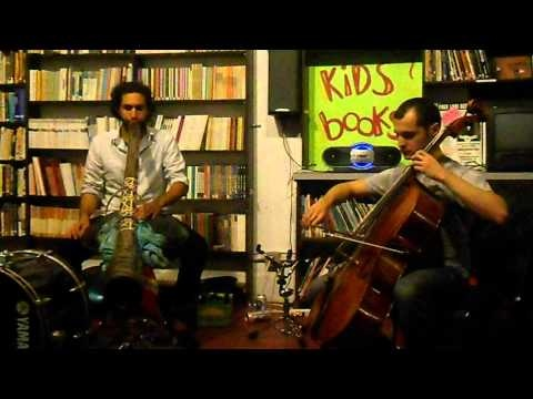 Peter Levitov & John David Eriksen (song 5, part 1 of 3) Cello musician  John David Eriksen is a Colombo - German who lives in Gainsville, Florida.