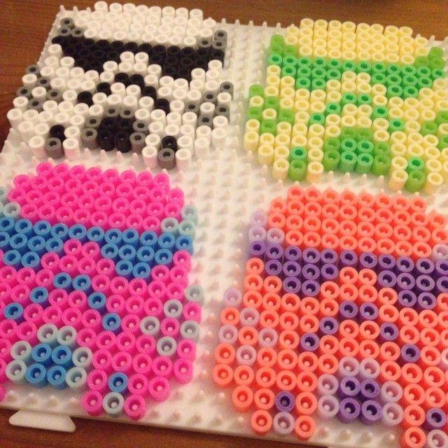 Colorful Stormtrooper helmets perler beads by thebeadspriteking