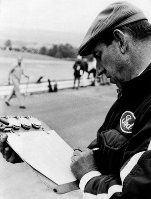 Ken Tyrrell noting down times
