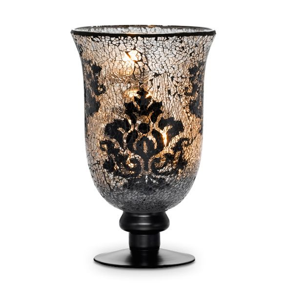 """FORBIDDEN FRUITS MOSAIC PEDESTAL HURRICANE  Write a review Write the First Review Item #:  P91653  Share on Facebook Share on TwitterShare on Pinterest Exquisite crushed glass mosaic hurricane features damask motif and painted base. Includes metal three-tealight stand. With tealight stand, use tealights; without stand, use a pillar, Escential Jar or large tealight. All candles sold separately. Decorative packaging. 9½""""h, 5¾""""w. $75.00 each"""