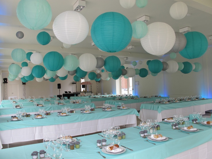 teal tablecloths and multiple color/size paper lanterns