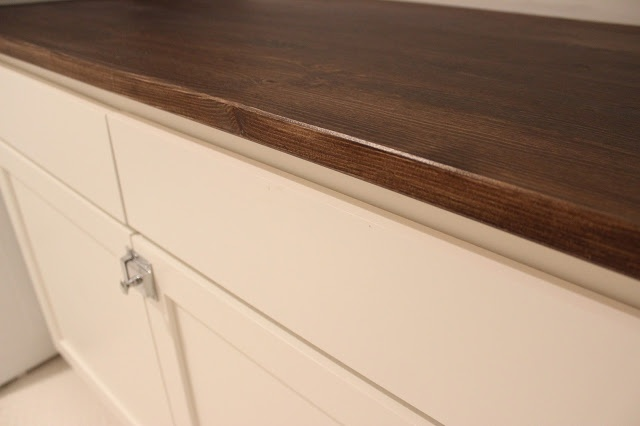 Ikea Desk Top Turned Laundry Room Cabinet Top by Dream Book Design
