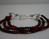 blood red bamboo and black onyx triple strand bracelet