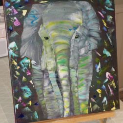 An abstract painting of an elephant. Confetti in the air. Painted with water soluble oil paint.