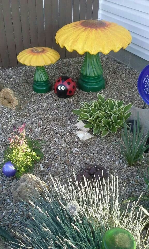 Sunflowers are birdbaths with top upsize dowm. Bowling ball ladybug.