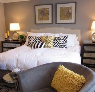 White Decorative Bedroom Pillows : - Feature wall grey, in between 3 creamy beige walls - grey arm chair - pops of yellow - lots of ...
