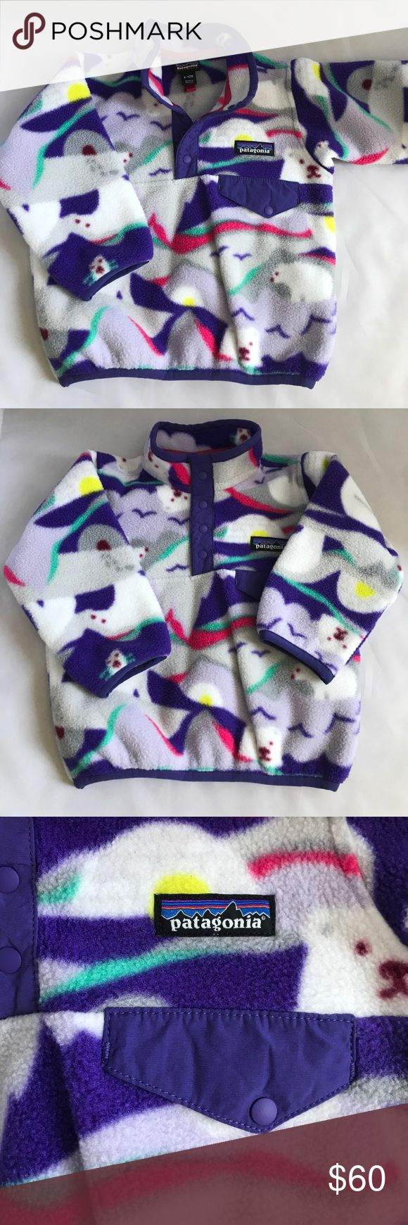 Patagonia fleece 6-12 M synchilla sweater purple Baby girl synchilla pullover fleece jacket size 6-12 months. From Patagonia. In excellent condition. Long sleeves. Snap buttons in the neck. Polar bear print. Purple, white, pink, yellow and green. Patagonia Shirts & Tops Sweaters
