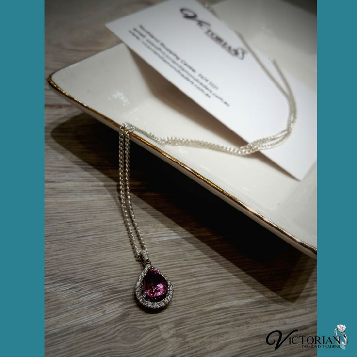 18 ct white gold pink tourmaline and diamond pendant.