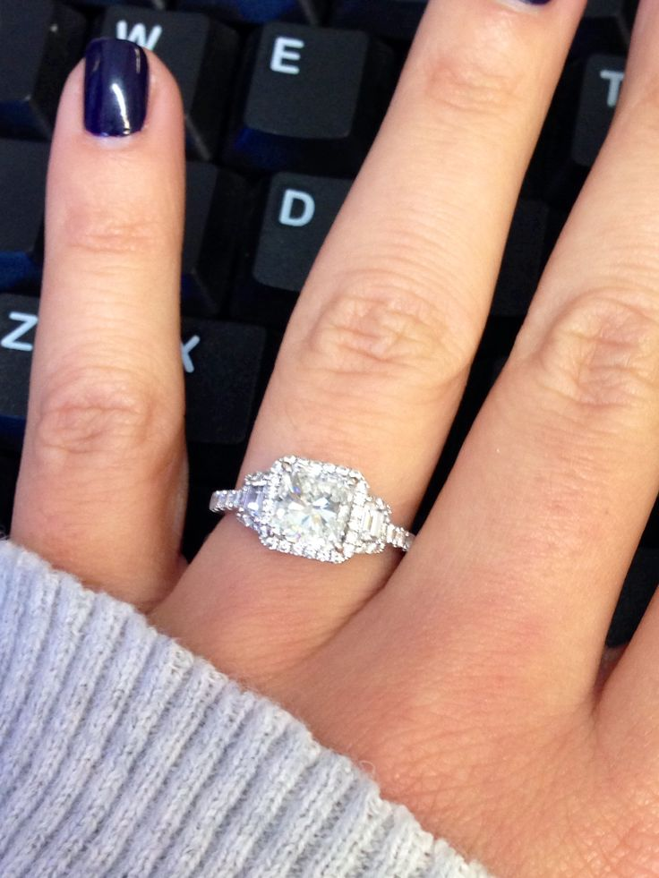 beautiful radiant cut engagement ring with side brilliant