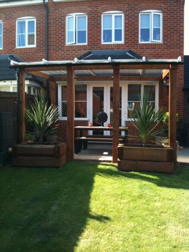 front of house looking at roses************************made from railway sleepers