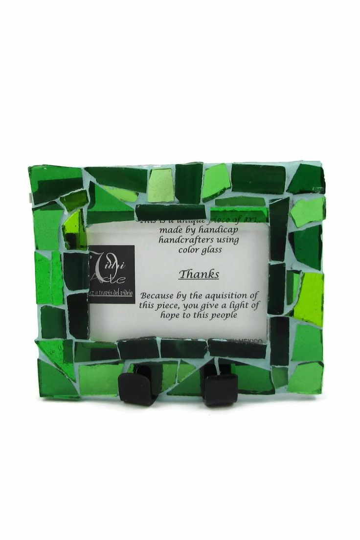 """Green Mosaic Glass Picture frame. Designed to hold a 2 by 3 Picture.   This beautiful piece is made by people with disabilities and women running away from domestic violence at the VidriArte Workshop. This Frame comes with a legend that reads """"This is a unique piece of art made by handicap hand crafters using color glass. Thanks because by the acquisition of this piece you give a light of hope to this people.""""  Made with Stained Glass it looks best close to a window where light can shine…"""