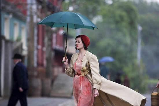 lovely and fluid scene - England perhaps? And the hat and dress are very vintage. :)