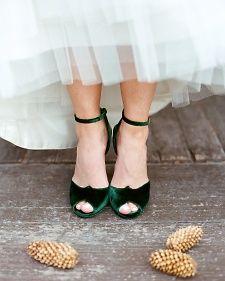Green velvet wedding shoes give a seasonal pop to a classic wedding dress
