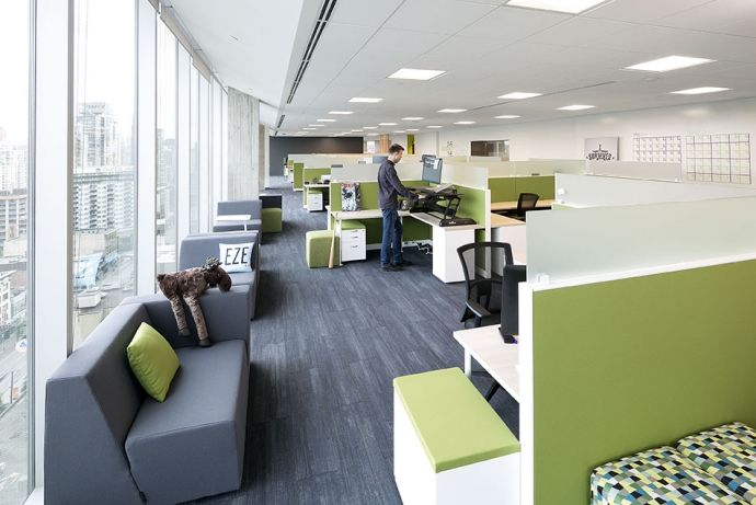 Interior design of the Vancouver offices of ACL by award-winning interior design firm SSDG Interiors Inc.  Open office, workstations, green, modern office, desks, standing workstation, standing desk