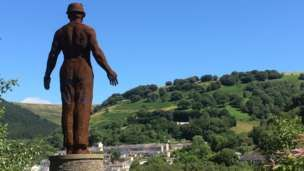 The Guardian statue looks over Six Bells in Blaenau Gwent