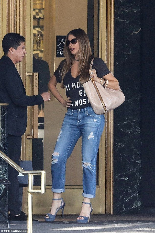 Mimosa es su mosa! Sofia Vergara showed her funny side - and lots of cleavage - in a puntatsic Spanish shirt on Wednesday