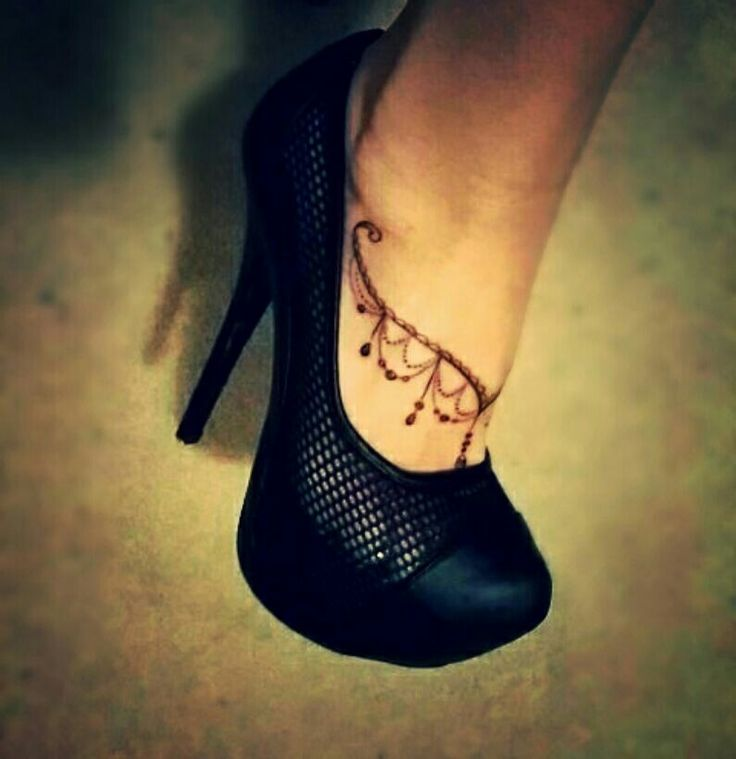 Girlie lace jewelry foot tattoo