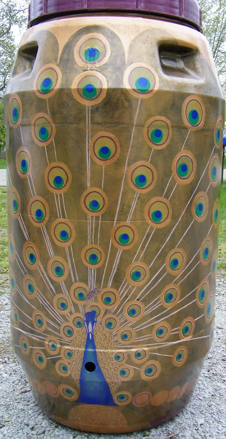 Learn how to make a rain barrel. Beautiful peacock painting on this barrel.