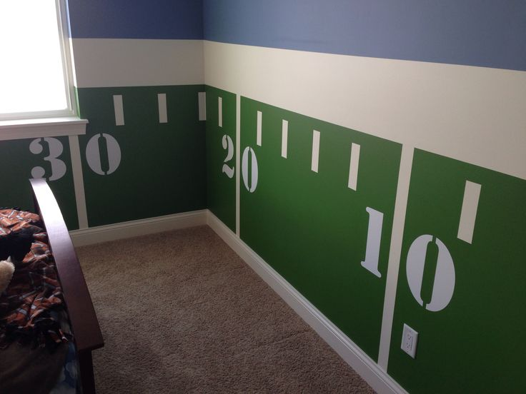 Create a unique chair rail effect with yard lines masked out with tape! Use decals to create the numbers.