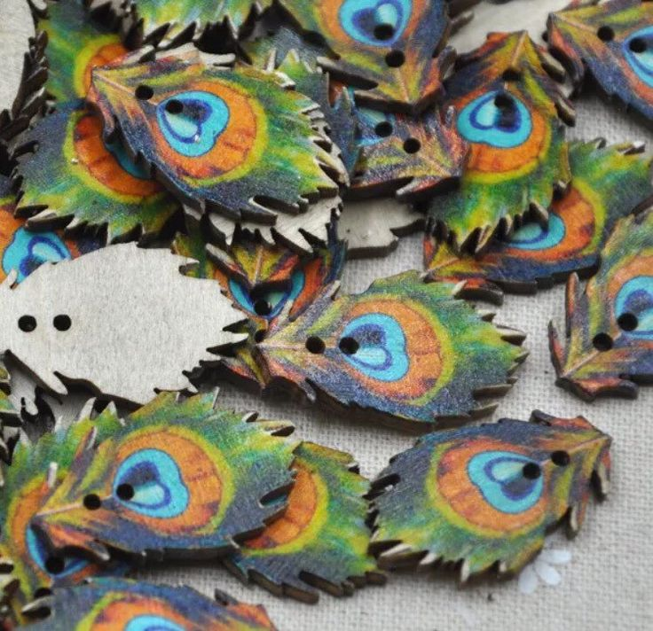 A personal favourite from my Etsy shop https://www.etsy.com/au/listing/487484880/peacock-feather-wooden-buttons-sewing