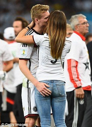 Weepy: Schurrle cries as he hugs girlfriend Montana Yorke on the pitch