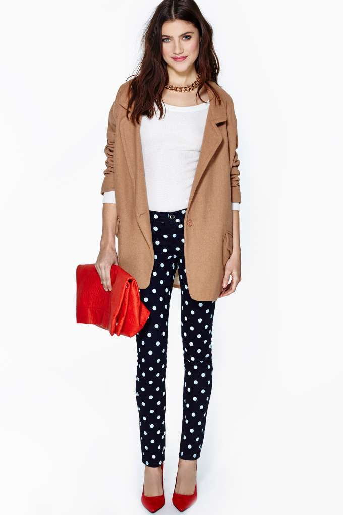 Polka Dot Skinny Jeans from Nasty Gal: Totally cute navy mid-high rise skinny jeans featuring a white polka dot print. Faux front pockets; button/zip closure. Stretch fabric. . Cotton/Polyester/Spandex Blend. 27''''/68cm waist. 38''''/96.5cm length. 30''''/76cm inseam. 9''''/23cm rise. Model is wearing US size 3. Measurements taken from US size 3. Machine wash cold. Made in USA Cool Spot Skinny Jeans