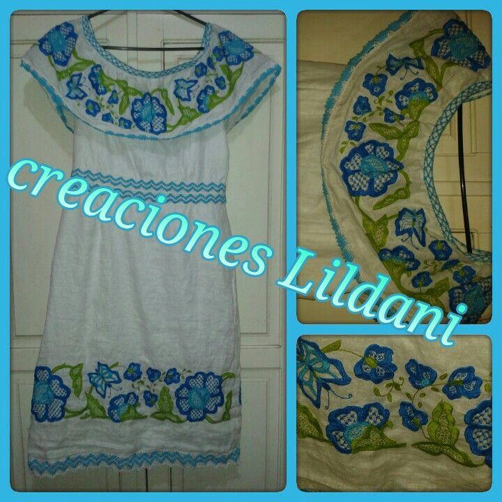 Hermoso vestido estilizado panameño,  confeccionado por artesanas tableñas en las técnicas de zurcido, calado en colores turqueza, celeste y verde lima