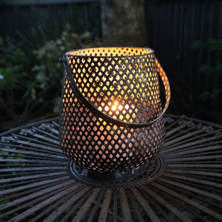 Gorgeous exotic candle lantern, metal laser cut design.  Looks so great on the deck with a citronella candle.