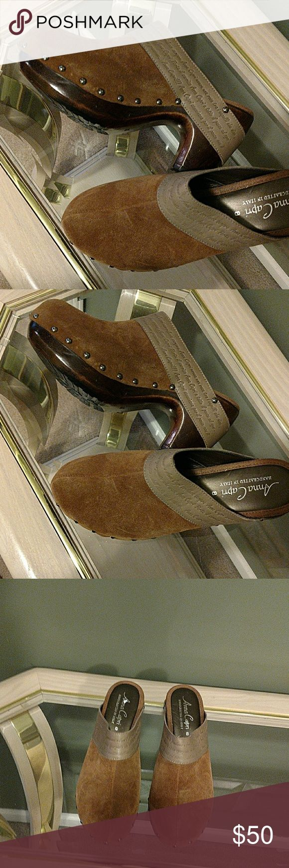 ANNA CAPRI CLOGS HANDCRAFTED IN ITALY Annac Capri Handcrafted in Italy Clogs. Suede and leather clogs with studs around the front to the back with a strap that hangs on the heel.  NWOT anna capri Shoes Mules & Clogs