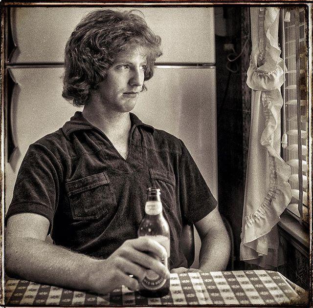 Brother Pat with Heineken in the old kitchen. #patrick #弟 #brother #youngest #portrait #1979 #bnwphotography #bnw_captures #bnw_photography #bnw #brancoepreto #svartvitt #брат #frère #bror #broder #αδελφός #deartháir #veli #irmán #برادر #hermano #Ilfordfp4 #120film #6x6film #filmscan #dumontnj by jimcallum