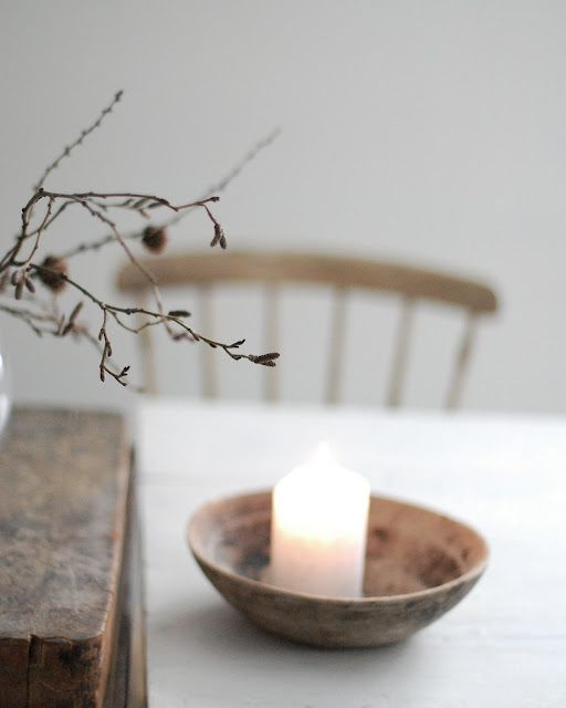 candles in shallow wooden bowls